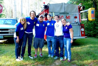 Daniel poses with City Year New Hampshire corps members as they volunteer at the Reach the Beach 200-mile relay race.
