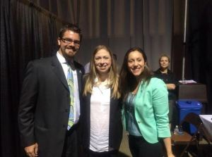 Alums Co-Executive Directors, Ben Duda and Mary Bruce, backstage with Chelsea Clinton