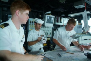 Then Quartermaster 3rd Class Paul Keays, Birte's husband (far right) helping to navigate the USS Harpers Ferry near the Philippines, 2005 (Photo credit: U.S. Navy photo by Journalist 2nd Class Brian P. Biller)