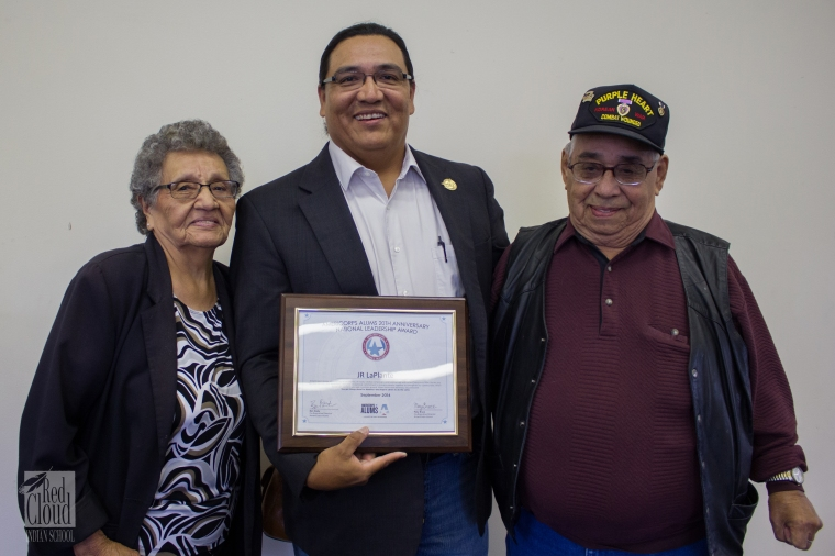 J.R. LaPlante with his parents at Red Cloud Indian School for Serve South Dakota's 20th anniversary of AmeriCorps event.