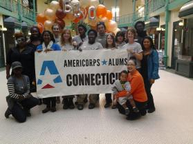 AmeriCorps Alums, members, and Raven 1 celebrate a great day of service with Boo Bash organizers Gabby F. and Natalie Pryce (kneeling)