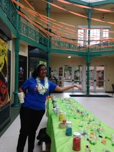 VISTA member Perdita Das prepares the sand art table in the Arcade Mall ahead of the rush.