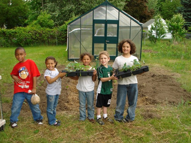 Children participating at a school garden at North Elementary School. This long time garden is a partnership between the school and community with space for neighbors to grow on site in addition to raised beds and orchard for education.