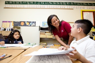 Wells Fargo volunteers connecting with students