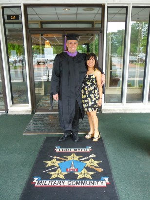 Tyler with wife Blanca on graduation day before receiving his 2012 Master of Science in Administration (MSA) concentrating in Public Administration from Central Michigan University.  Tyler attended graduate school at Fort Meade on the weekends while serving as an Enlisted Sailor.