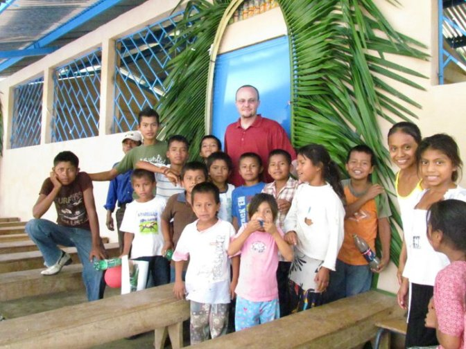 Nick with children at the inauguration of a school supported by Hug It Forward and Peace Corps Guatemala in Alta Verapaz, Guatemala