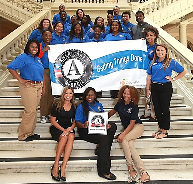 Joyce with GA AmeriCorps members at the State Capitol.