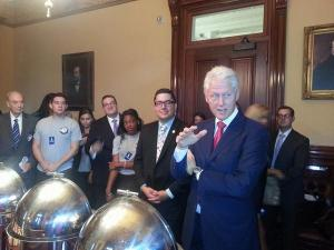 William and currently serving AmeriCorps members listening to President Bill Clinton reflect on the 20th anniversary of AmeriCorps
