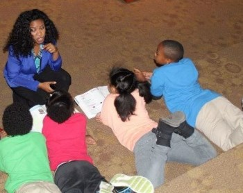 Andrea with a group of youth at Giving Net Civic Engagement program.