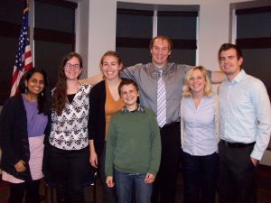 Ramya Kumaran (left) and Dan Sheets-Poling (back-center) with Fellows.