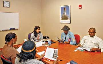 Aman holding a GED tutoring session during AmeriCorps